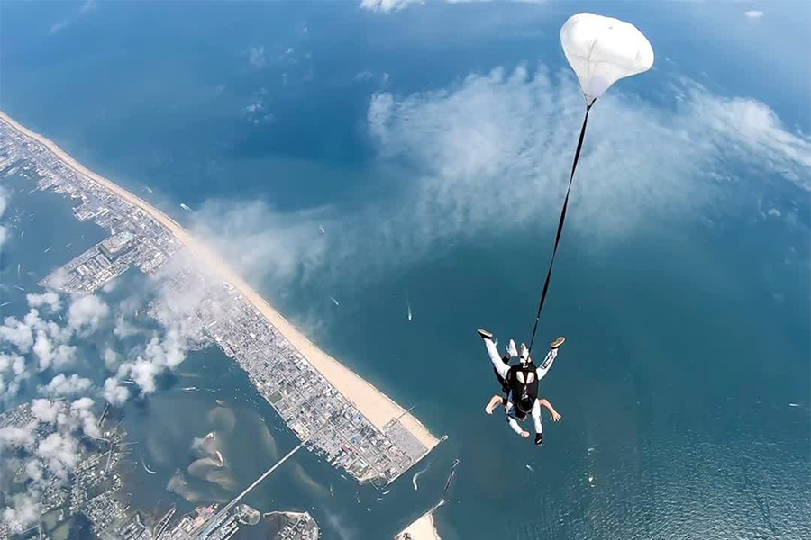 A skydiver using their parachute at Skydive OC